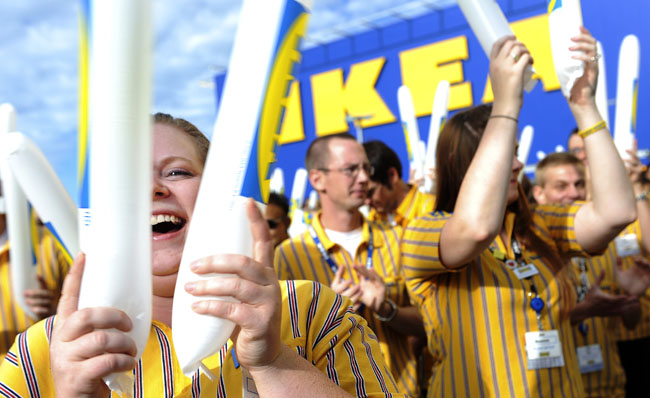 IKEA, a home furnishings retailer, opened the doors of it new store in Centennial on Wednesday, July 27, 2011. It is a 415,000 square-foot store employs more than 400 coworkers. Employee Christina Torres pounds a noisemaker at the opening. Cyrus McCrimmon, The Denver Post