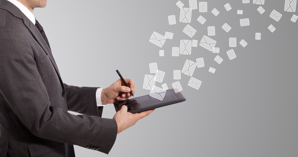 business man write mail on tablet, grey background